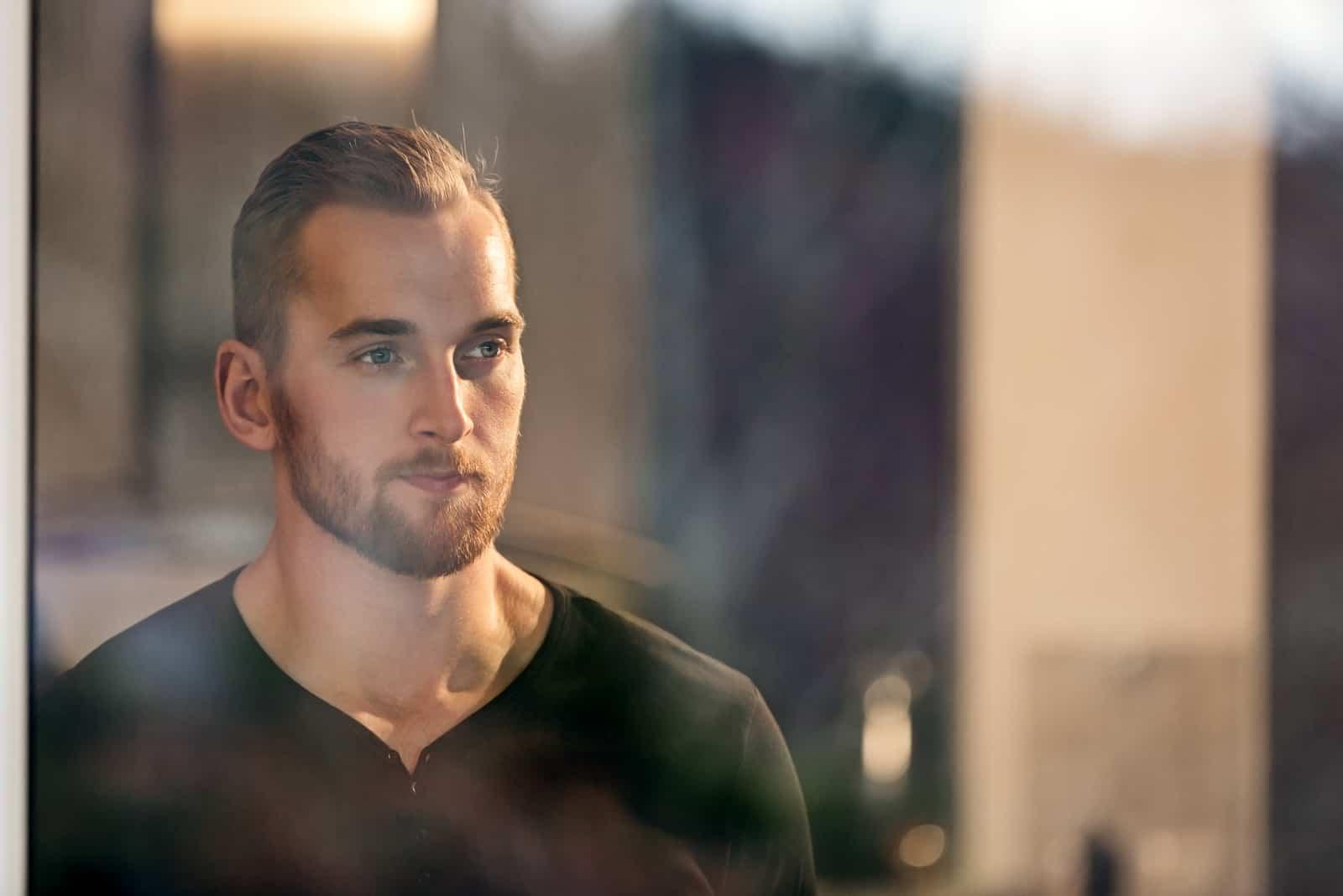 man wearing a black long sleeved shirt