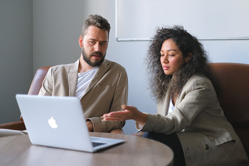 two colleagues working together in the office