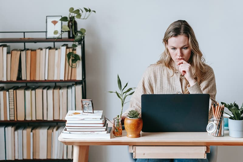 woman working on laptop and thinking