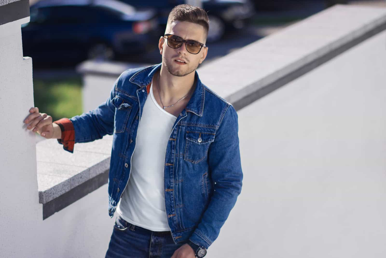 young handsome man outdoors wearing sunglasses