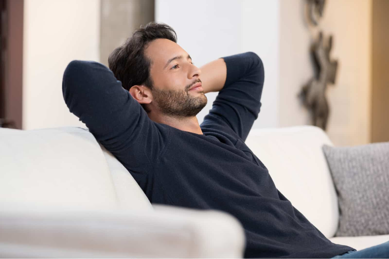 young man resting on sofa