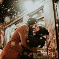 couple kissing on the snow