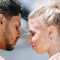 couple facing each other about to kiss