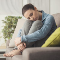 woman curled on couch