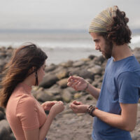 man and woman standing on the beach