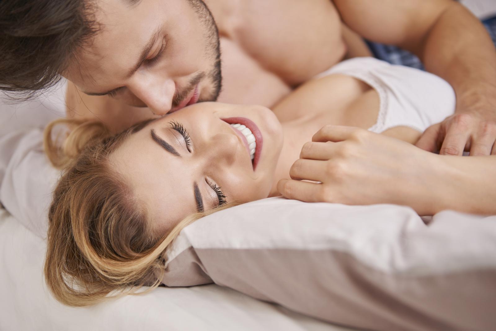 a man kisses a woman on the cheek