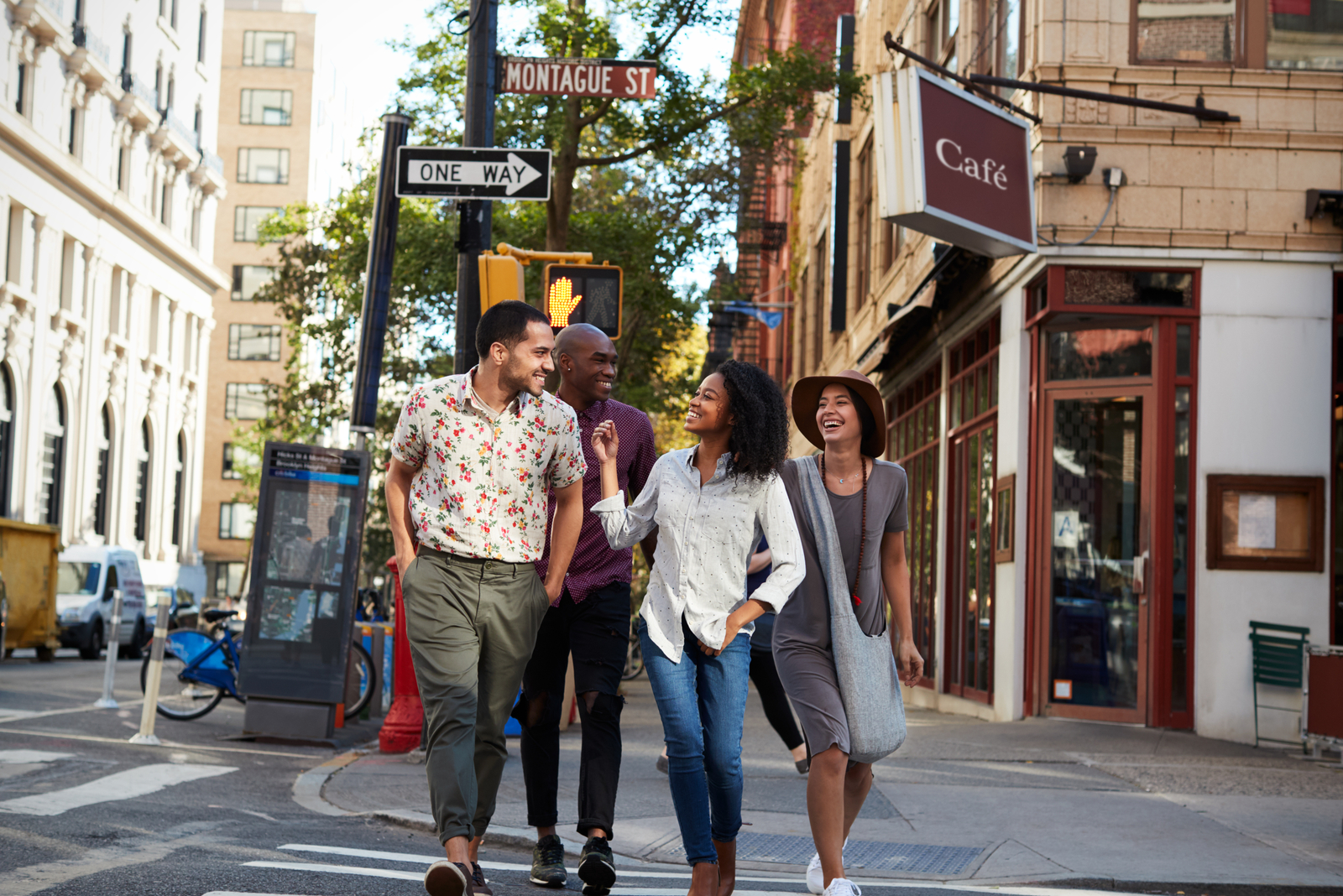 friends walking down the street and laughing